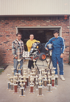 President Peri with go-kart racing trophies